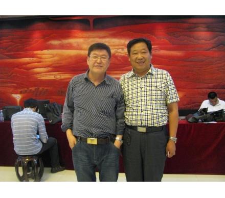 與著名畫家、哈爾濱美協主席吳團良先生合影