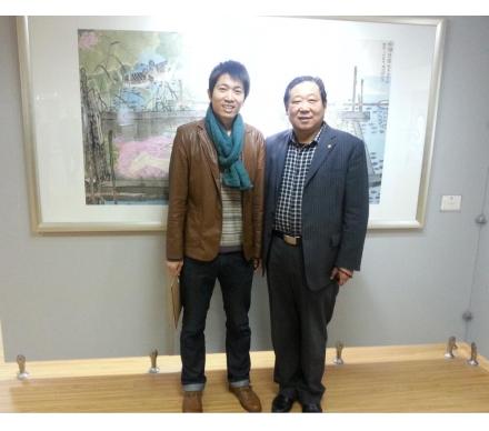 與著名畫家盧曉峰先生合影