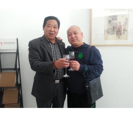 與著名畫家師行坤先生合影