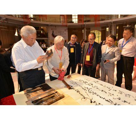 與國臺辦主任林軍,臺灣著名書法家高明達在筆會現場
